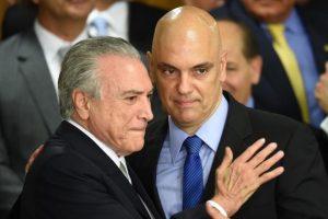 O presidente interino Michel Temer (E) e o ministro da Justiça e Cidadania, Alexandre de Moraes (D) Foto: EVARISTO SA / AFP